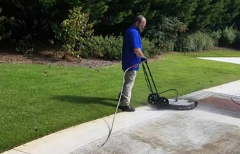 Marietta Pressure Washing worker cleaning concrete paver