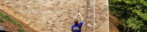 Marietta Pressure Washing worker cleaning brick wall